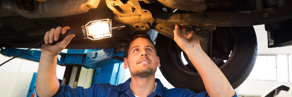 A mechanic inspecting underneath a vehicle - MOT Tonbridge